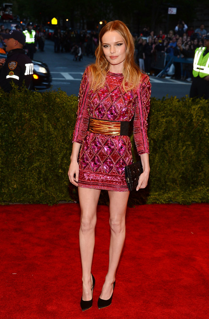 At the 2013 Met Gala, Kate Bosworth hit a punk-chic high note, donning a fuchsia embellished Balmain mini cinched with a wide gold-detailed belt.