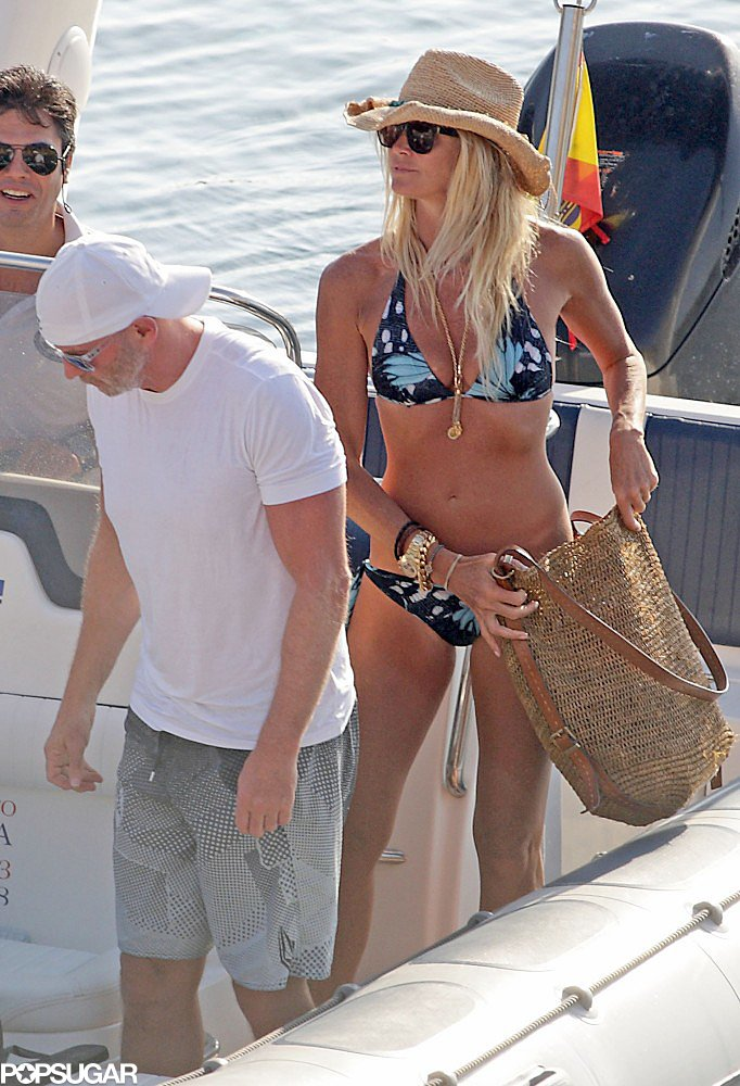 Elle Macpherson showed off her toned bikini body while hanging on a boat in Ibiza, Spain in July 2012.