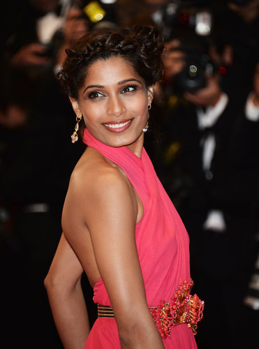 Freida Pinto wore a bevy of braids in her hair to create a striking woven updo at the Great Gatsby premiere.