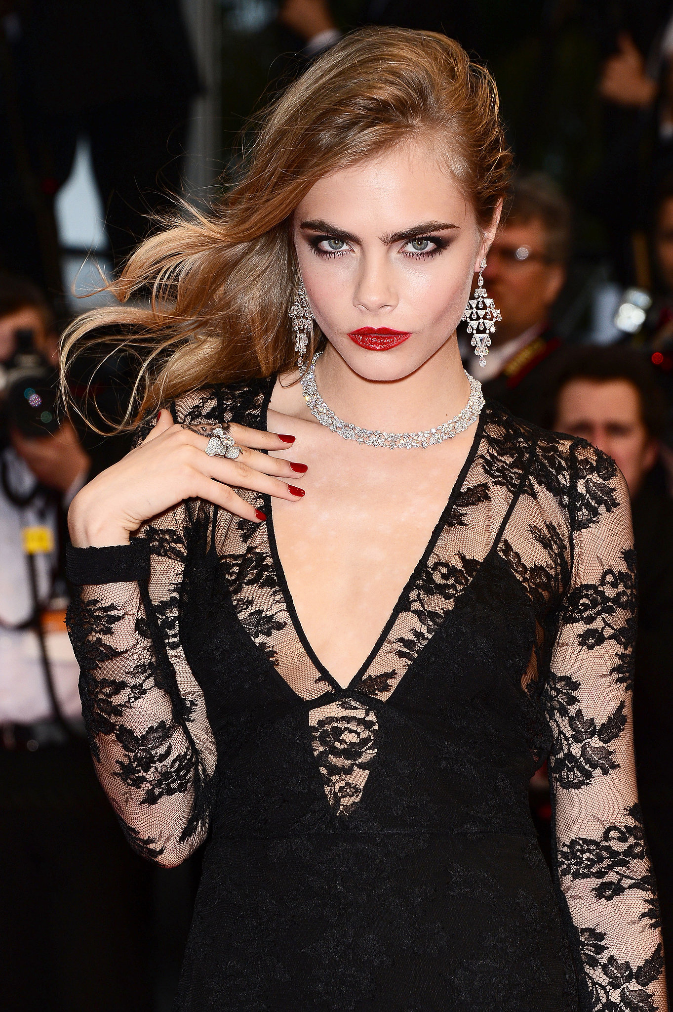 Cara Delevingne matched her deep-red lipstick with a brick-red nail polish for a supersultry combination.