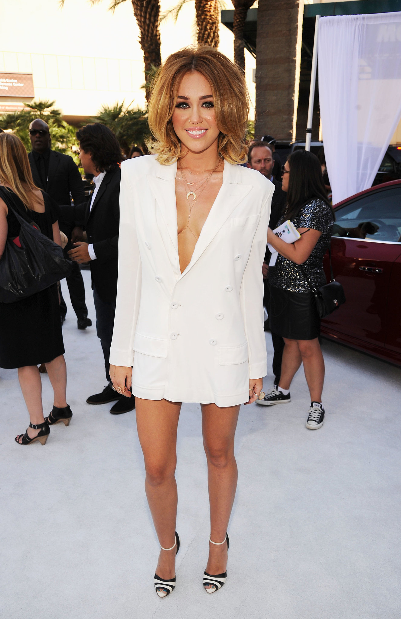 Miley Cyrus wore nothing but a white blazer to the May 2012 Billboard Music Awards.