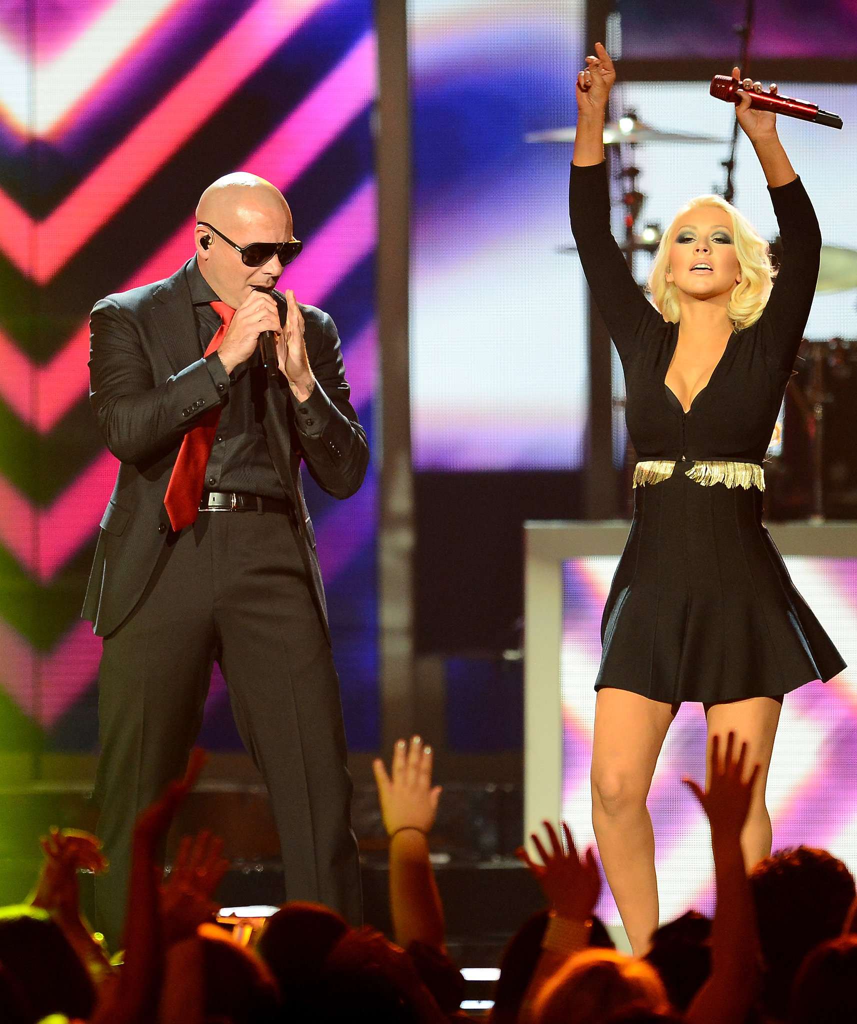 Pitbull and Christina Aguilera shared the sta