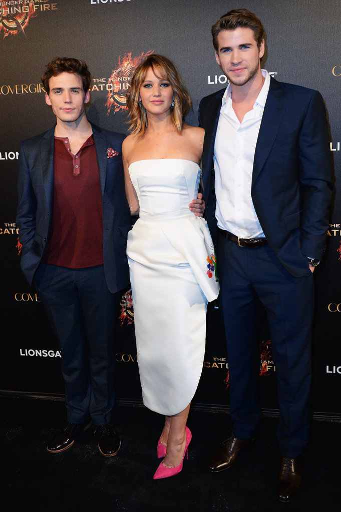 Sam Claflin, Jennifer Lawrence, and Liam Hemsworth got together at the Catching Fire party.