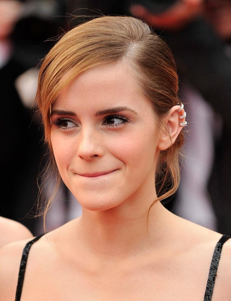 Emma Watson accessorized with three ear cuffs.