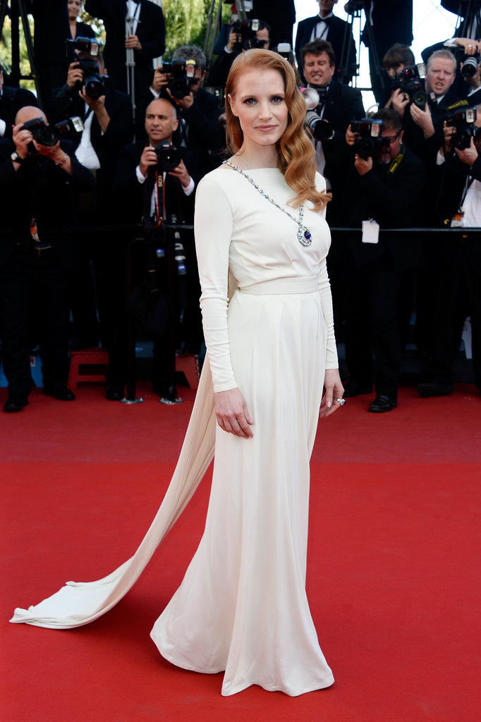 Jessica Chastain wowed at the Cleopatra premiere in a white caped Versace Collection gown, which she finished with a statement jeweled necklace.