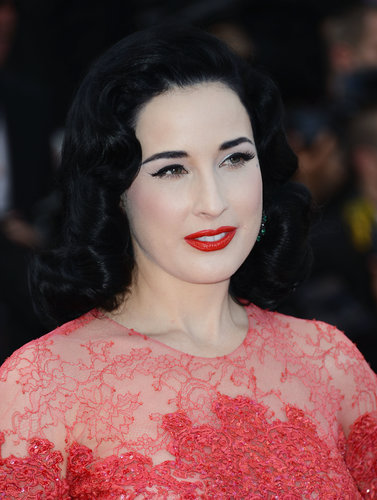 Dita Von Teese wore her signature red lipstick on the Behind the Candelabra red carpet in Cannes.