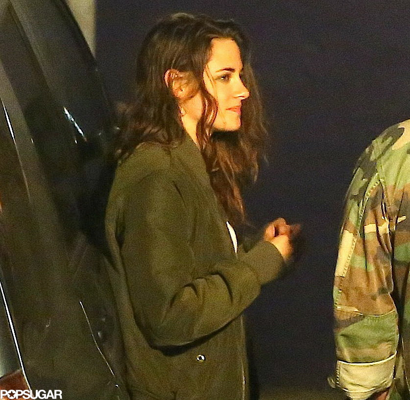 Kristen Stewart chatted with friends outside a restaurant.