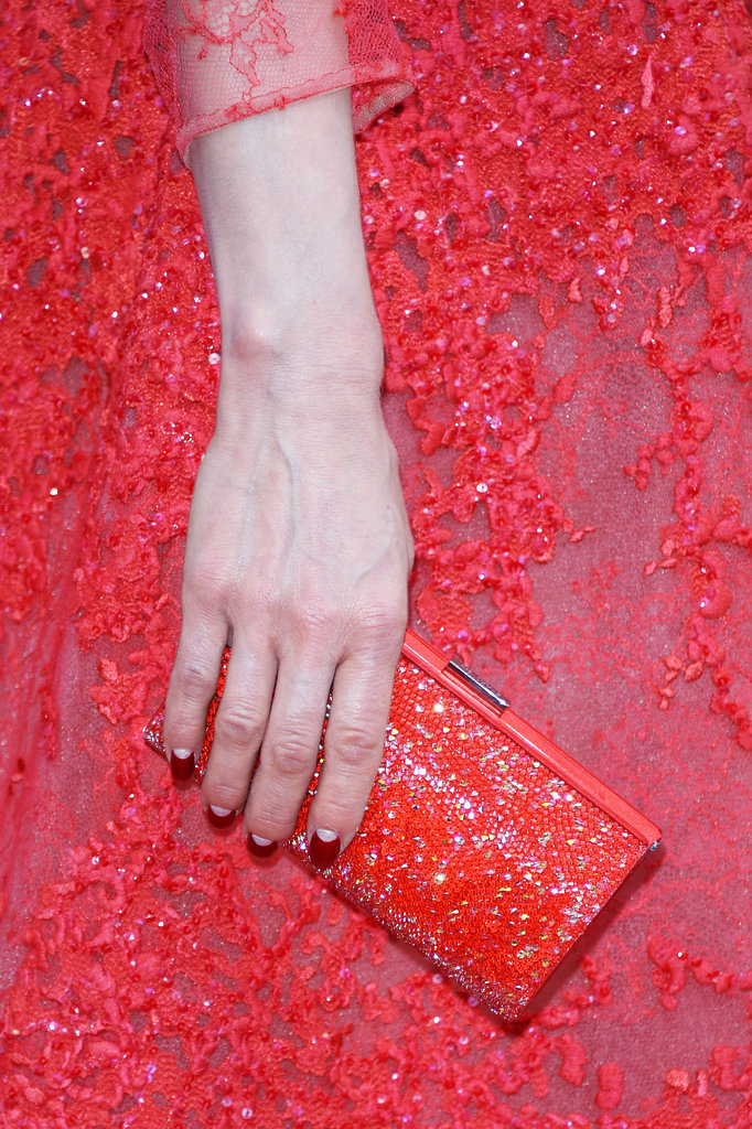 Dita Von Teese carried a red sparkly clutch to match her intricate gown.