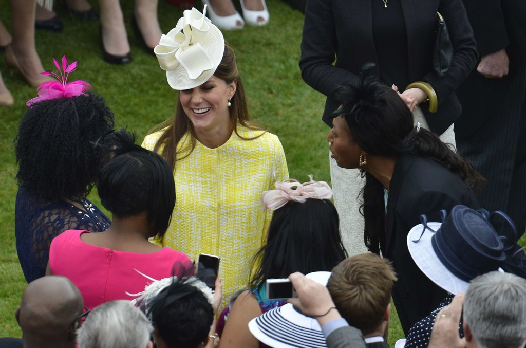 Kate smiled while talking to garden party guests.