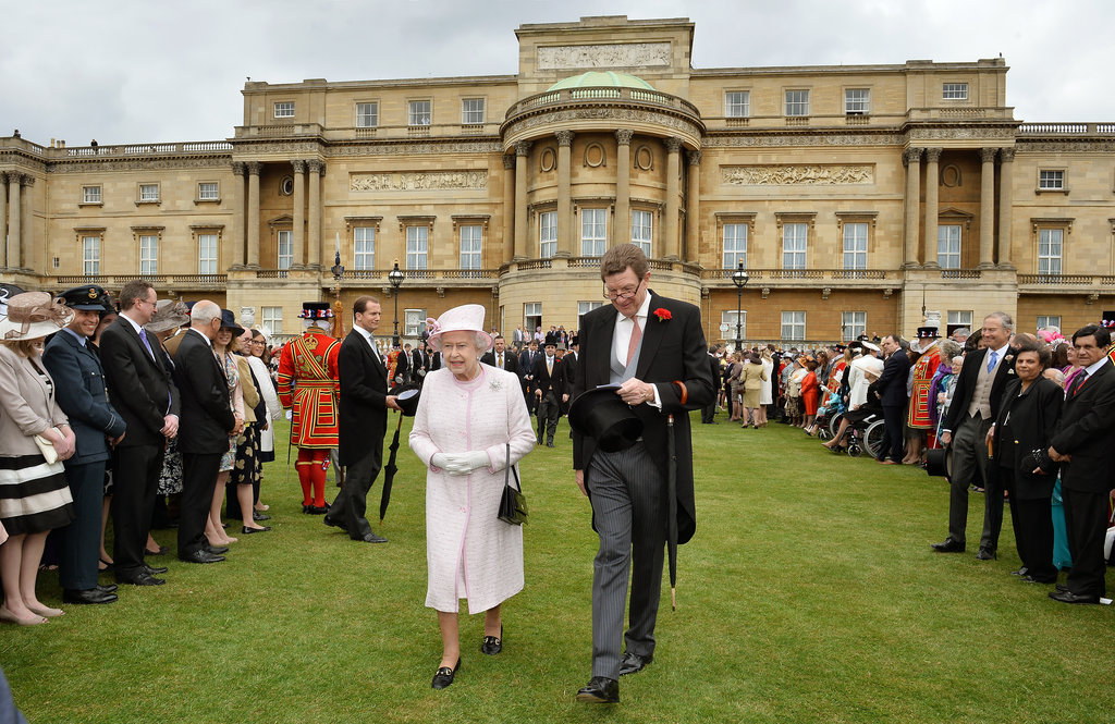 The queen smiled as she greeted her guests.