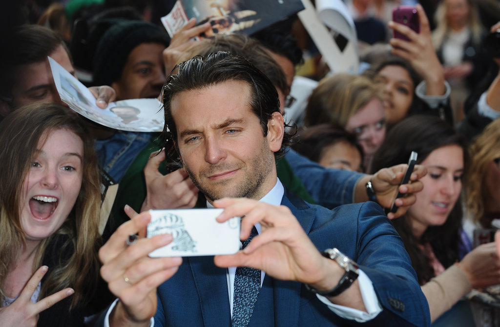 Bradley Cooper snapped a shot of himself with fans at the London premiere of The Hangover Part III in May 2013.