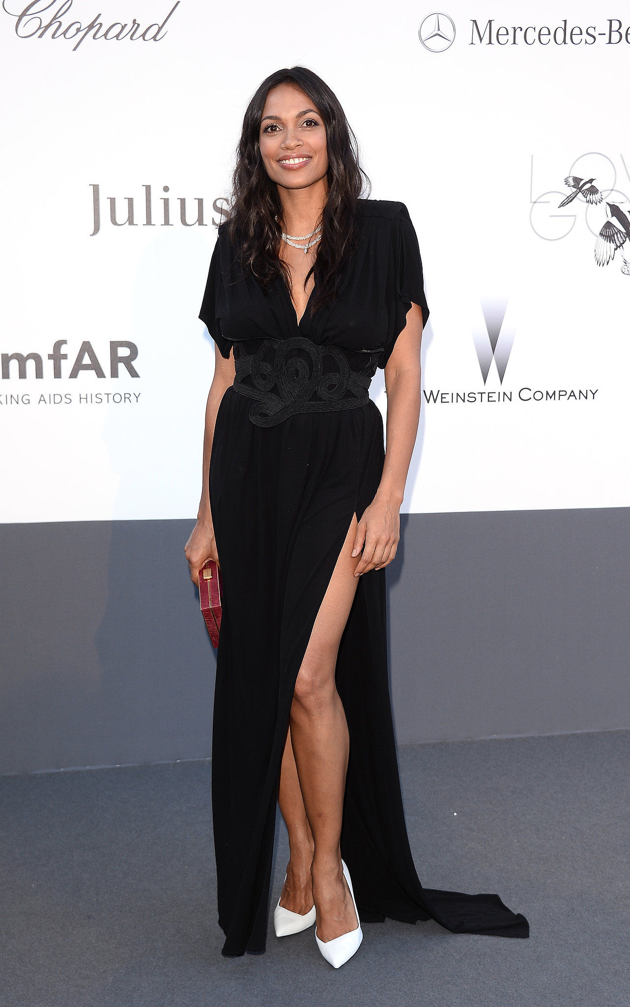 Rosario Dawson showed serious leg on the amfAR red carpet in Cannes on Thursday.