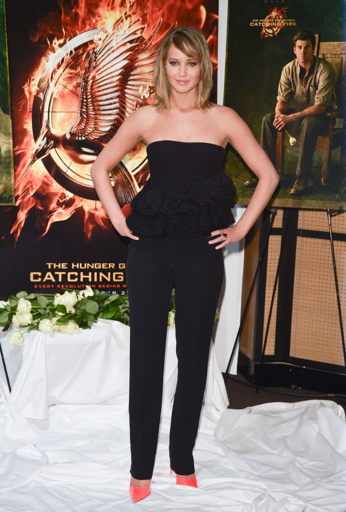 At the Hunger Games: Catching Fire photocall in Cannes, Jennifer Lawrence helped her black strapless Dior jumpsuit pop with her hot-pink pumps.