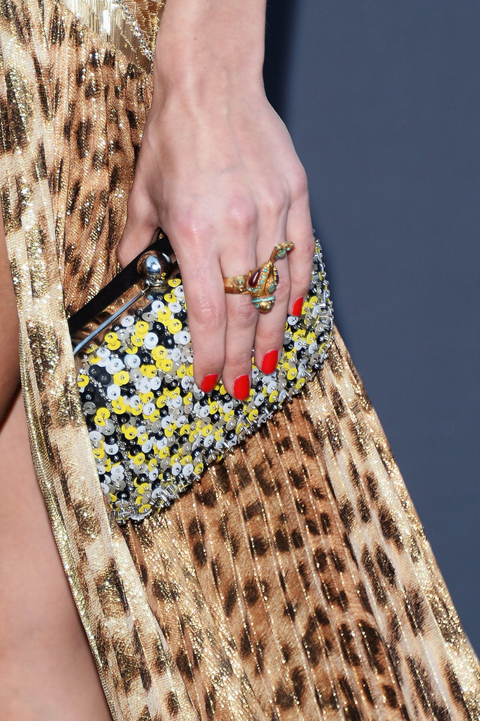 Olivia Palermo carried a black, yellow, and white sequined clutch.