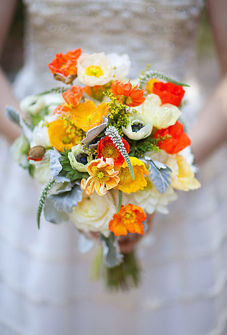 """A Poppy and Anemone Bouquet We love this superbright contemporary bouquet by the ladies at California-based event-design company Bash, Please. """"The bride for whom we designed it absolutely loved poppies, so we chose florals and greenery to accent their vibrant colors,"""" explain designers Kelly Harris and Paige Appel. The balance of intense citrus hues with elegant whites and greens — here, achieved using anemones, veronicas, dusty millers, solidasters, and ranunculus — work equally well in a rustic outdoor setting or an indoor, urban environment. Browse more orange wedding flower ideas. Related: Rose Gold Wedding Shoes Source: Birds of a Feather"""