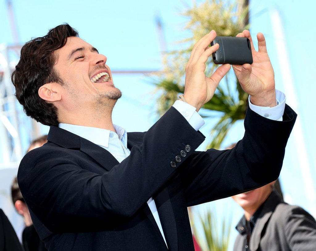 Orlando Bloom smiled while taking a picture at the Zulu photocall on Saturday at the Cannes Film Festival.