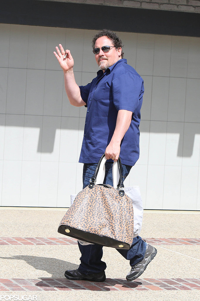 Jon Favreau waved to photographers.