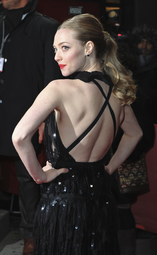 What better way to show off a backless gown than with a cascading ponytail. Just check out Amanda Seyfried's over-the-shoulder pose at the Berlin debut of Les Misérables.