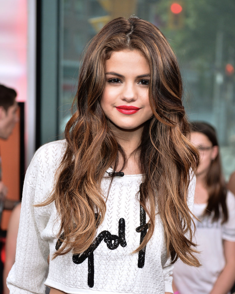 Selena Gomez was in Canada earlier this week for an appearance on MuchMusic. The singer and actress wore her recently lightened hair in waves that showed off her caramel highlights.