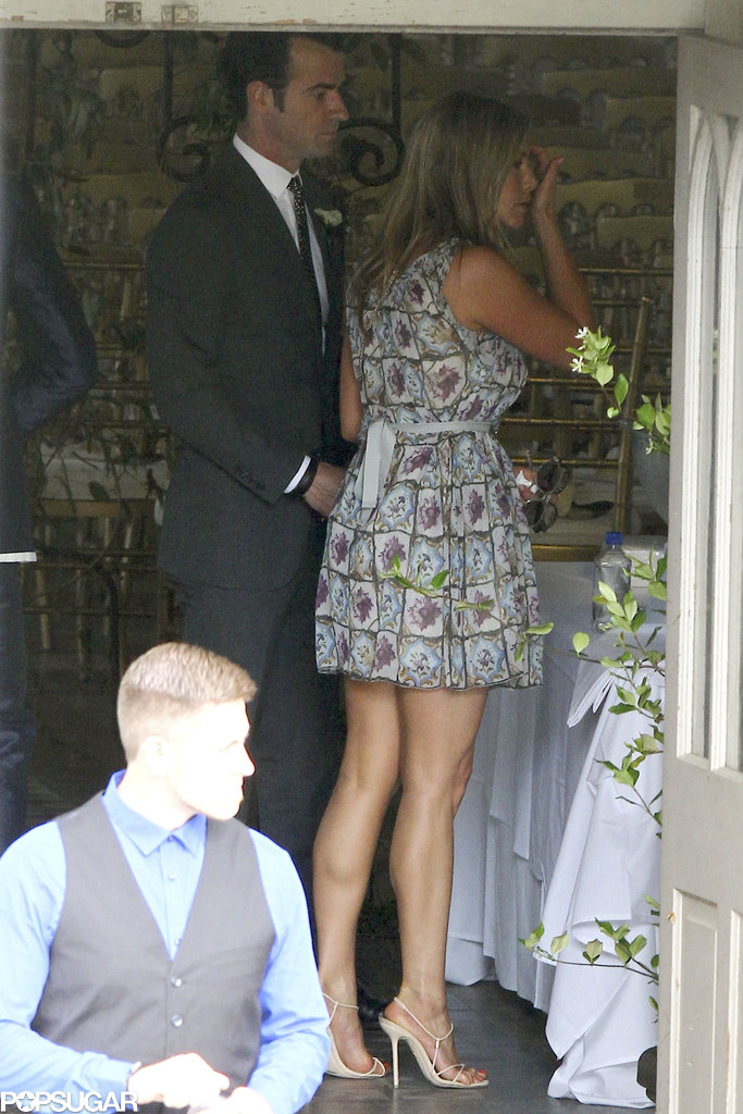 Jennifer Aniston wore a printed dress while attending the wedding with Justin Theroux.