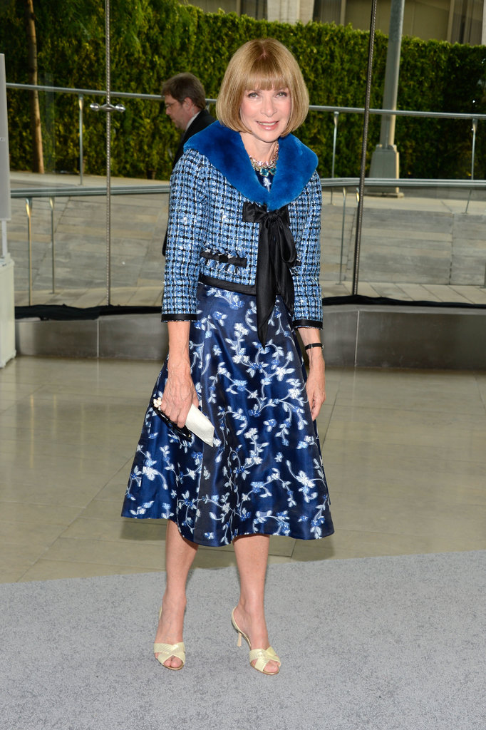 Anna Wintour stuck to her signature ladylike style in a blue printed dress and a coordinating tweed jacket.