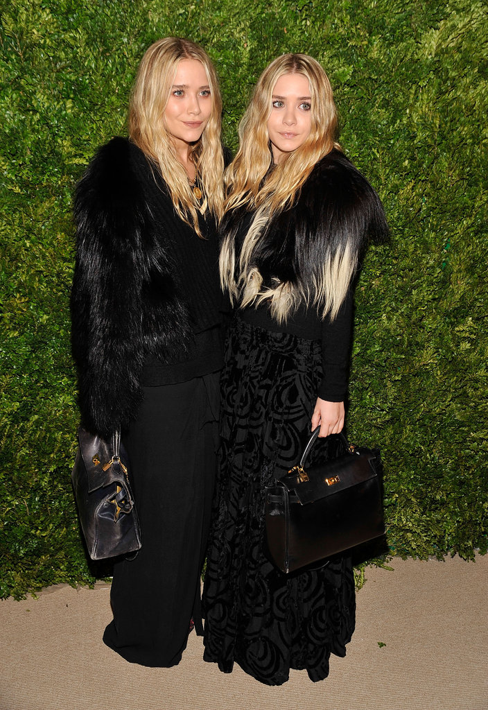 Twinning combo: Complementing furs and matching leather totes were the girls' look of choice for the CFDA/Vogue Fashion Fund Awards in 2003.  Mary-Kate fused fur, leather, and wool to create her monochromatic look. Ashley layered a plush ombré topper over her jacquard maxi skirt.