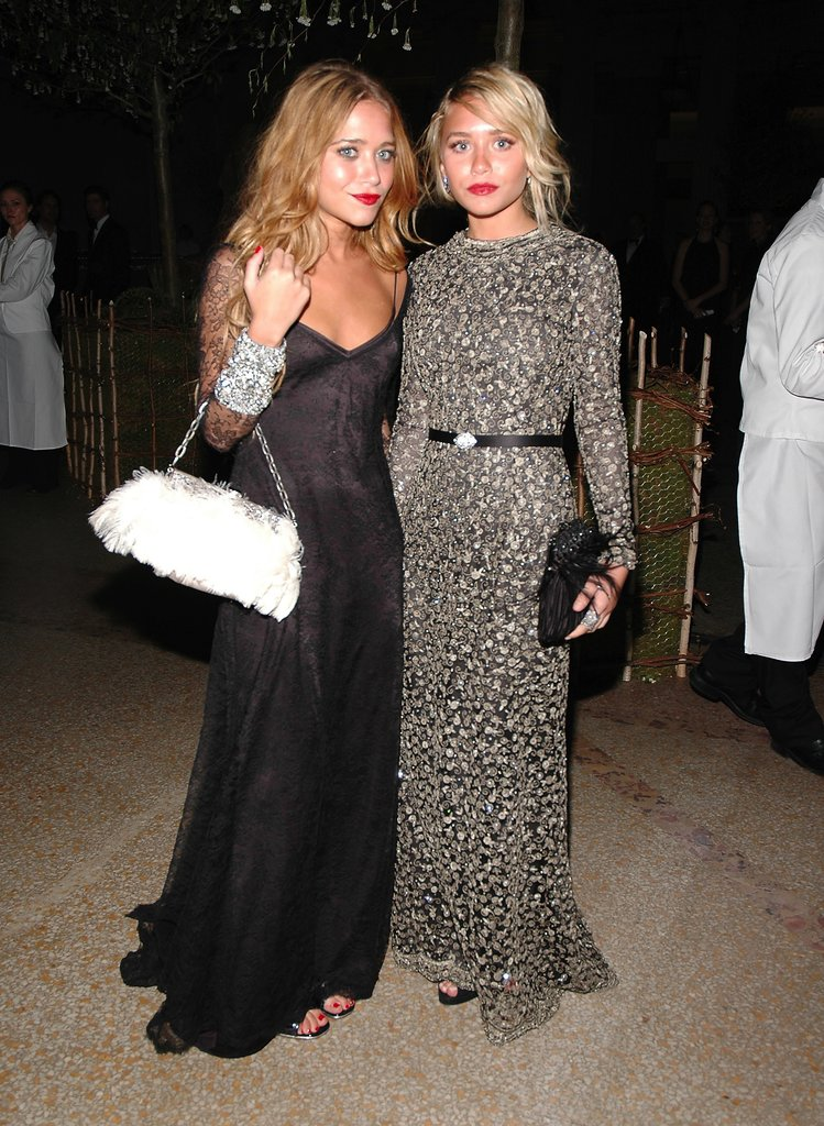 Twinning combo: The dynamic duo upped the glam factor with feathered bags and red-hot lipstick at the 2006 Met Gala.  Mary-Kate posed next to her partner in crime donning a slinky black gown by Badgley Mischka with lace sleeves and a white feathered bag. Ashley polished off her beaded Badgley Mischka creation with a black feather clutch and diamond cluster earrings.