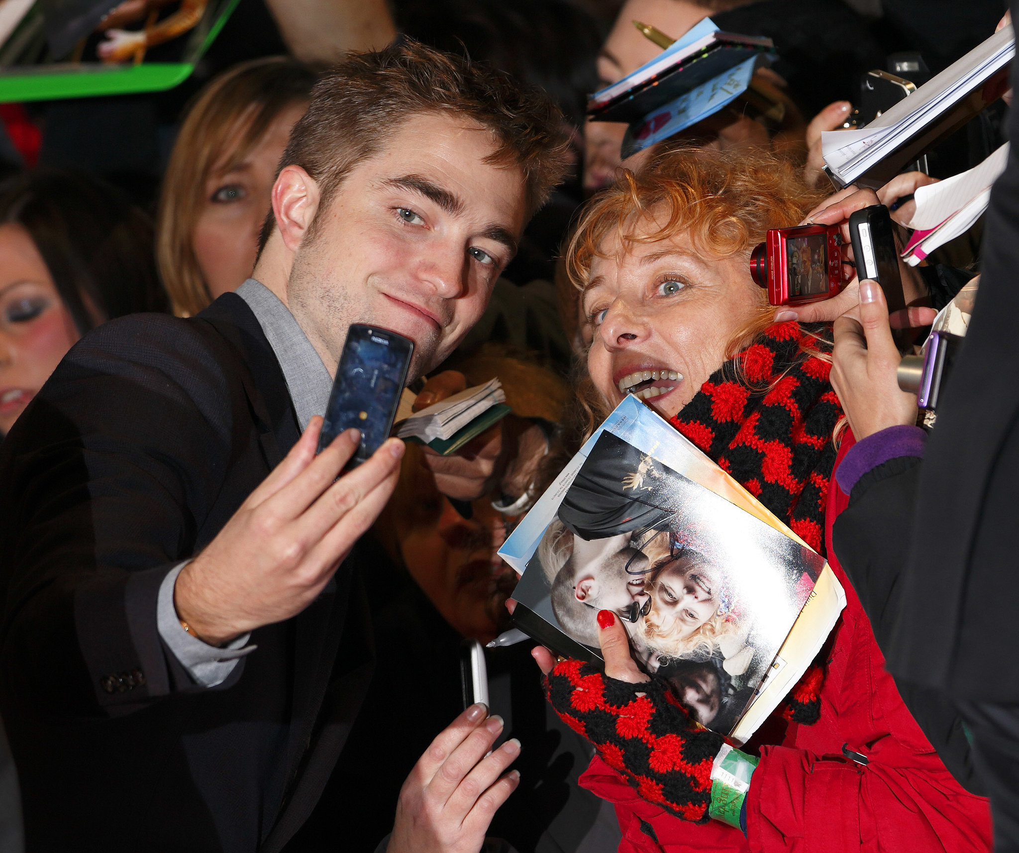Robert Pattinson smiled with a fan in November 2012 before heading into the London premiere of Breaking Dawn Part 2.