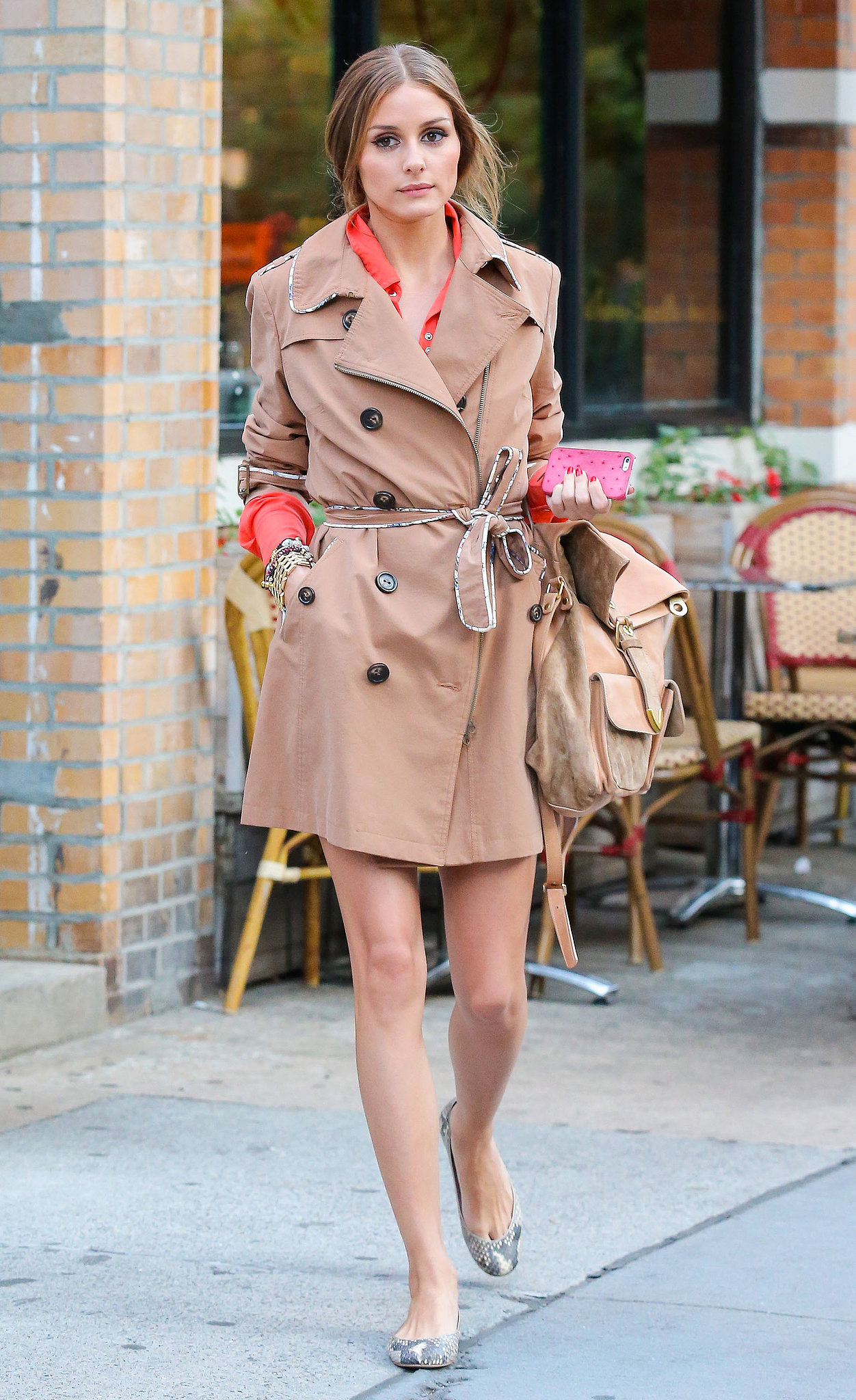 While out to lunch in NYC, Olivia Palermo layered up in a chic trench coat with cool piping, then finished with snakeskin flats.
