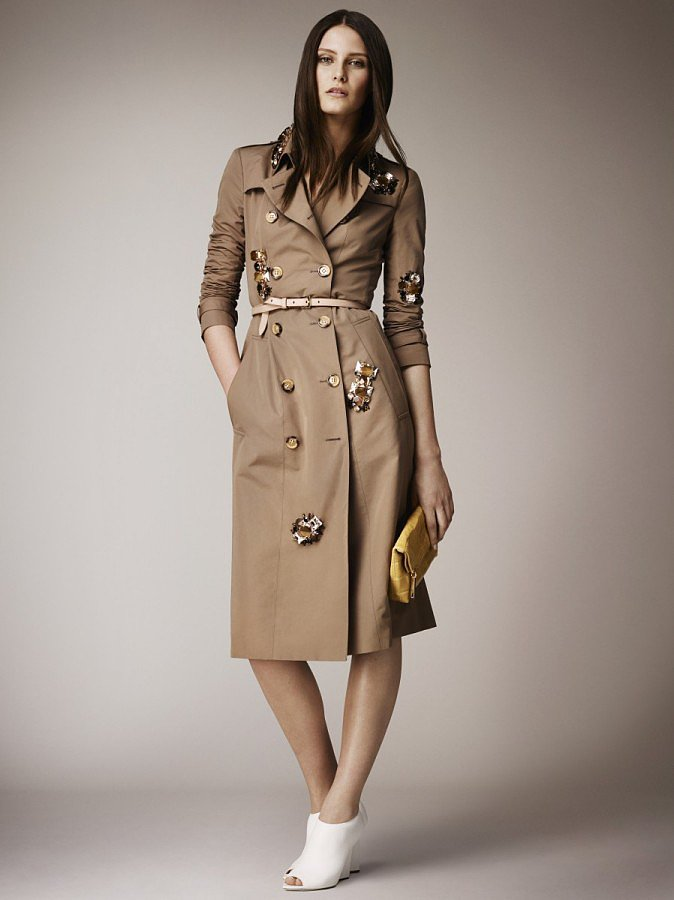 Again, the timeless trench is updated, this time with a smattering of oversize gemstones. Source: Burberry