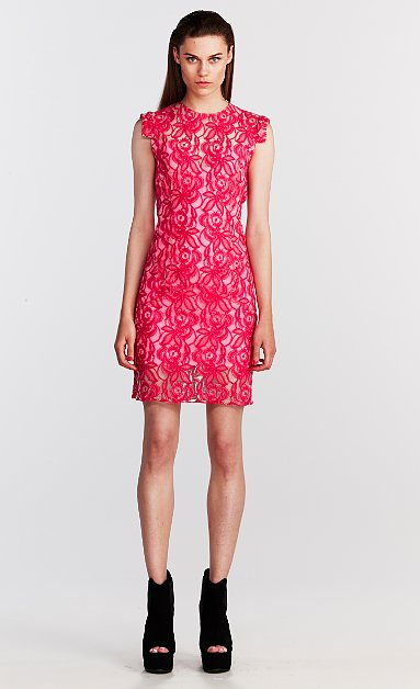 The high neckline and sleeve details on this This Is Genevieve hot-pink pick ($210) make it feel more fashion-forward than your everyday lace style.