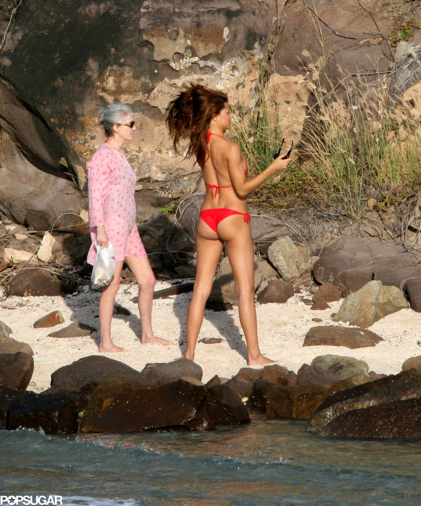Adriana Lima showed off her figure on a walk with a friend while vacationing in St. Barts in December 2006.