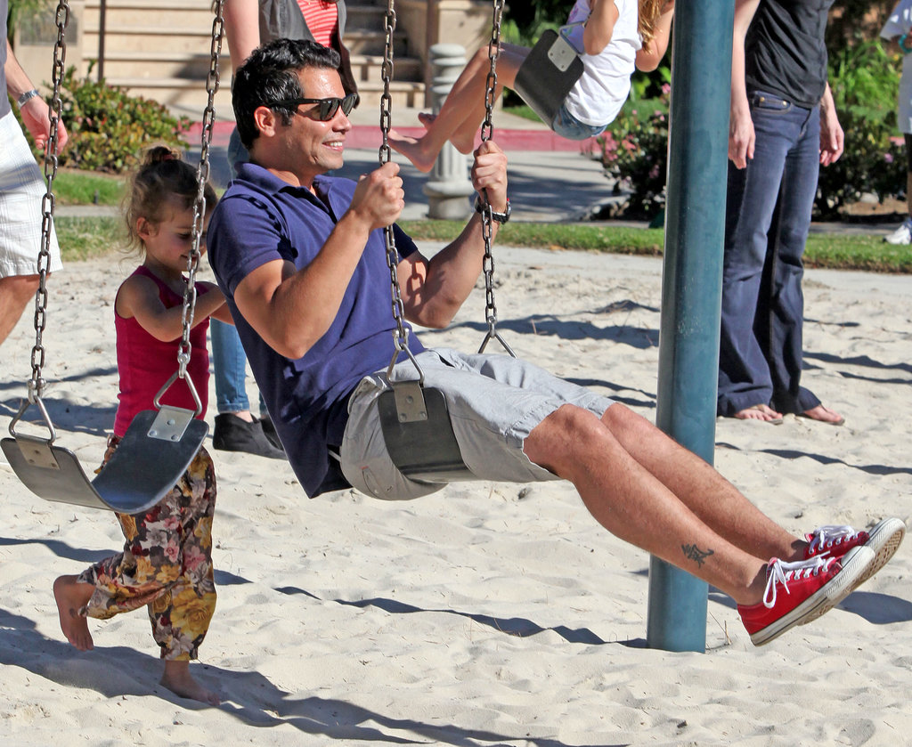 Honor gave her dad, Cash Warren, a push on a swing set during a January 2012 trip to the playground in Beverly Hills.