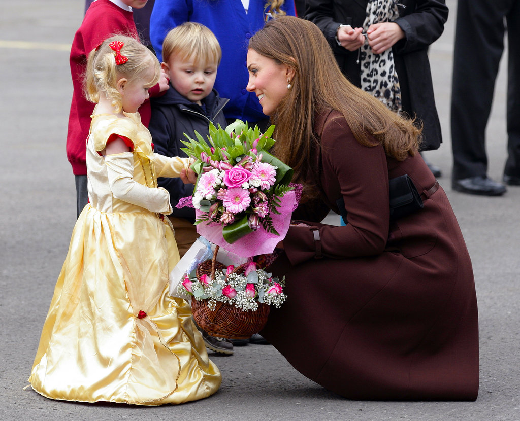 Kate Middleton chatted with a girl in a princess costume in March 2013 when she toured the town of Grimsby in England.