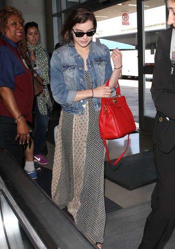 A maxi dress and a denim jacket are quite the dynamic traveling duo. The dress will keep your legs warm (and keep your whole body stylish), while the denim jacket will give you that effortless edge on and off the plane.