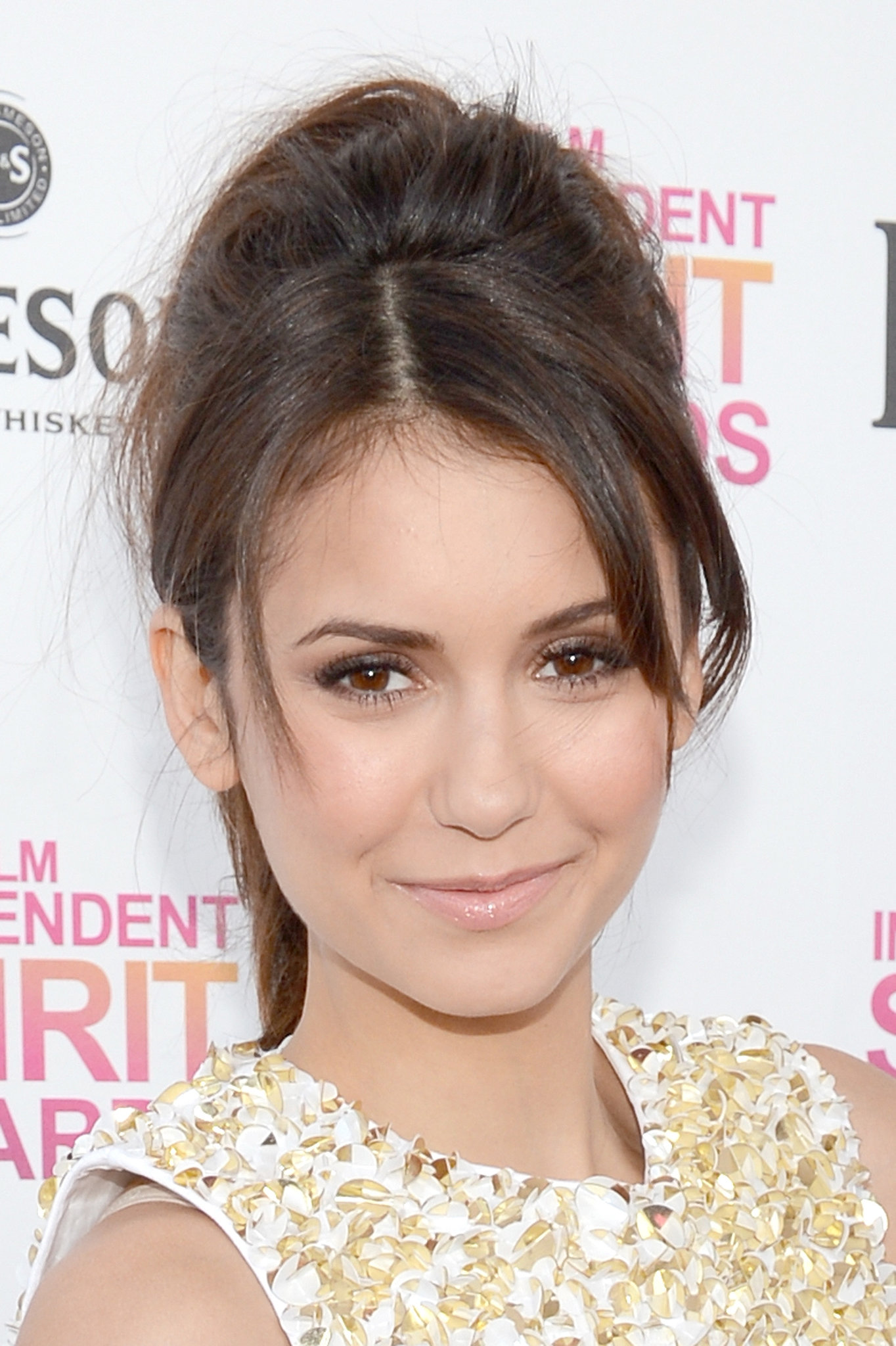 Nina Dobrev's high ponytail ups the cute factor with some volume and parted bangs.