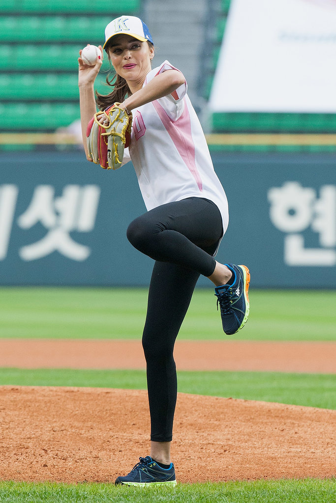 Miranda Kerr fired one past home plate during a baseball game in Seoul, South Korea, in June 2013.