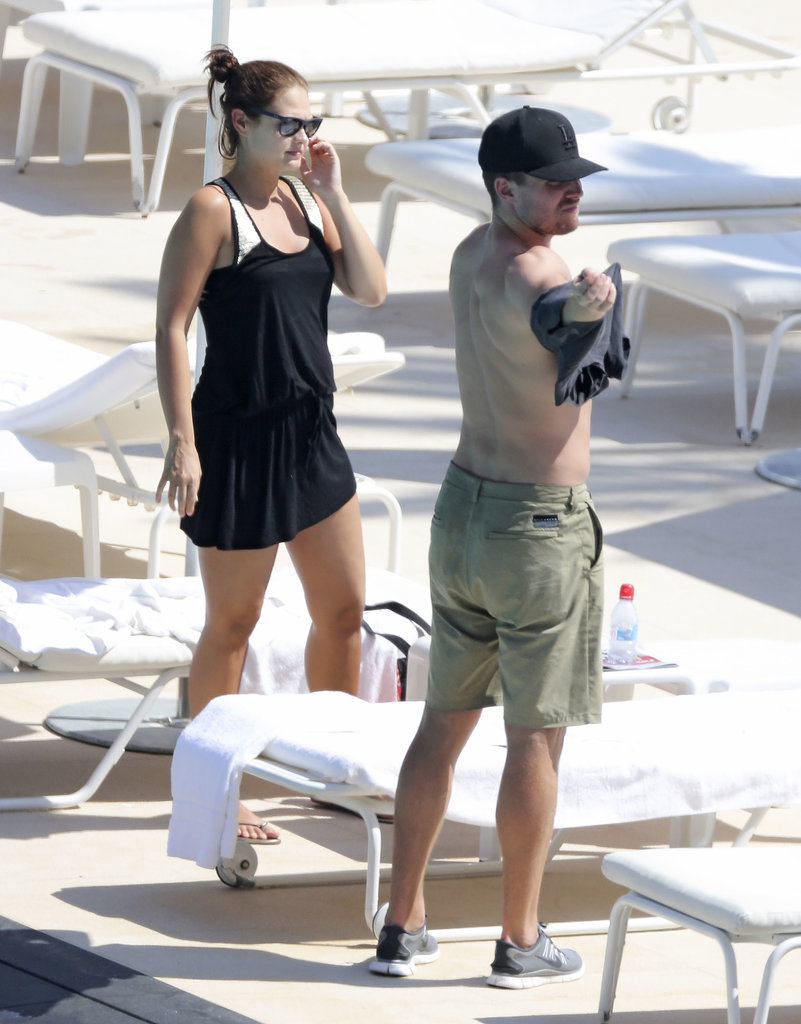 Cassandra covered her bikini with a little black dress by the pool in Monaco on Thursday.