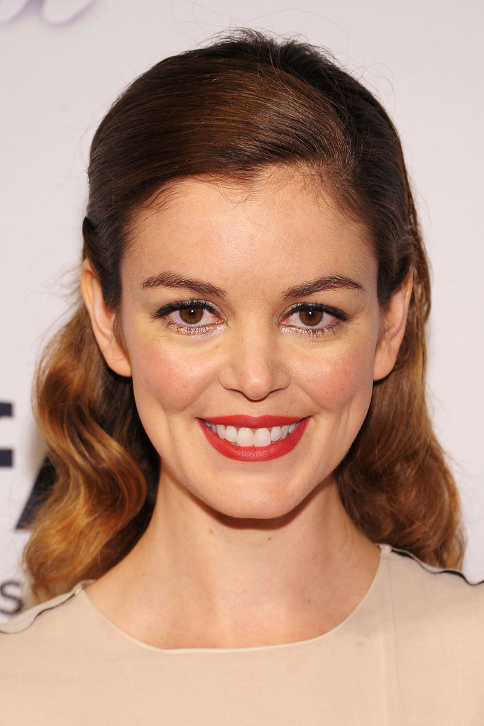 A simple half-updo and red lipstick made for a sweet, demure look on Nora Zehetner.
