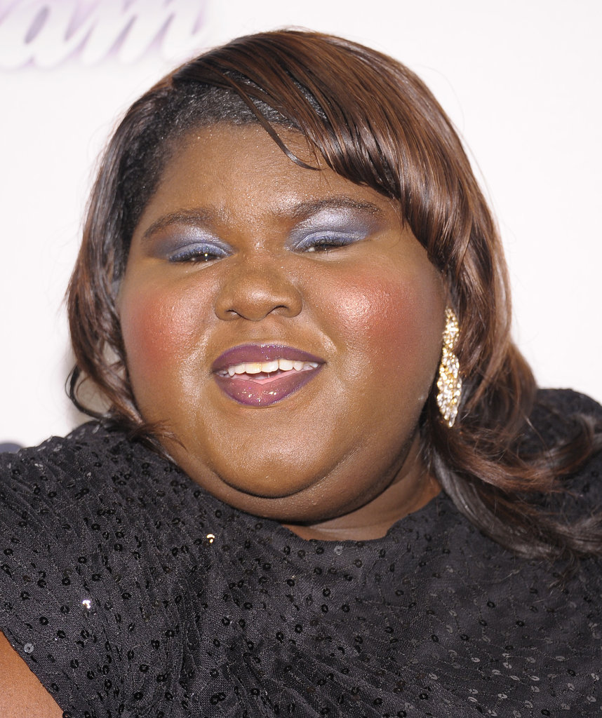 Gabourey Sidibe went for a vintage roll in her hair, while her makeup focused on pops of color with icy blue shadow and rosy cheeks.