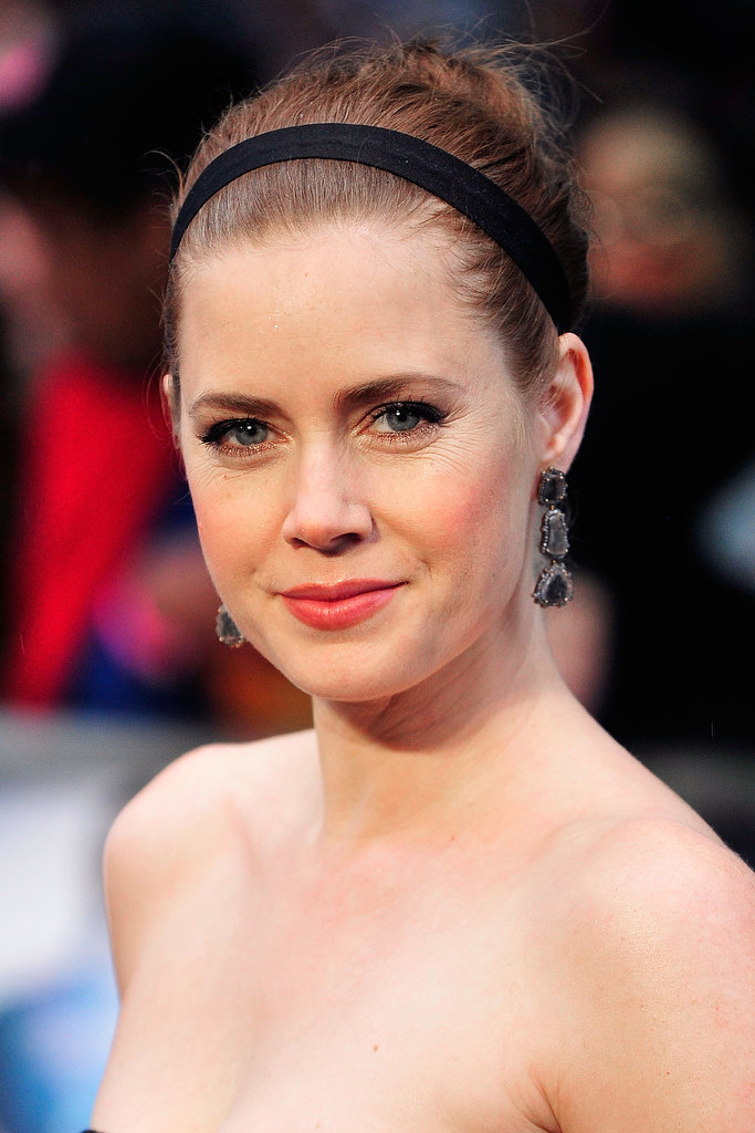 Amy Adams was on the red carpet for the Man of Steel premiere in London wearing a bun and headband combo. She kept her makeup simple with rosy lips and cheeks.