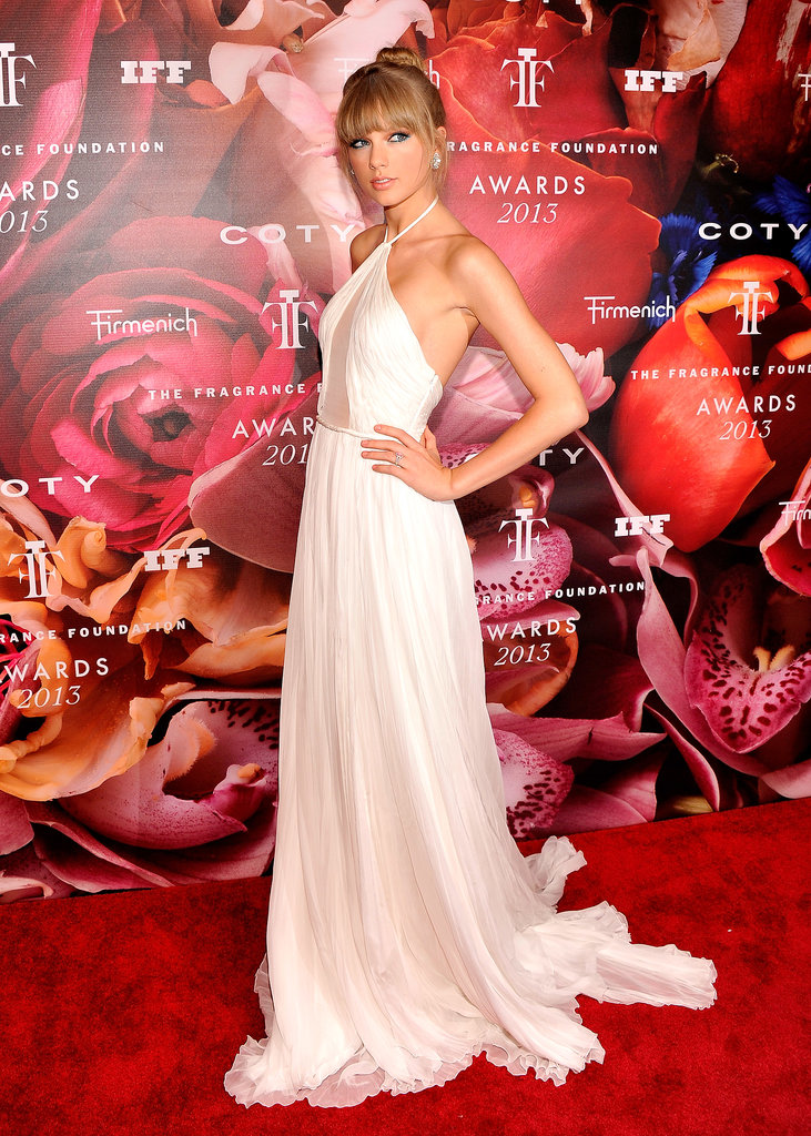 Taylor Swift had a total glamazon moment on the red carpet of the Fragrance Foundation Awards in this white Emilio Pucci gown.