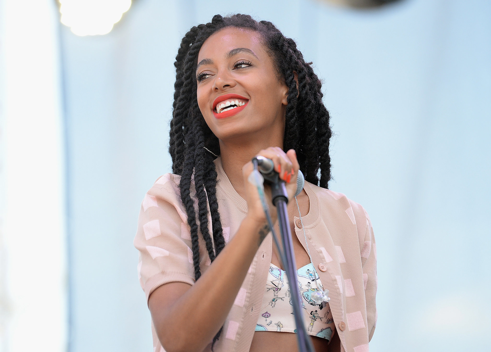 Singer Solange Knowles kept things in the same color family at the Bonnaroo Music and Arts Festival, wearing tangerine lipstick, bright orange nail polish, and a peach-hued top.