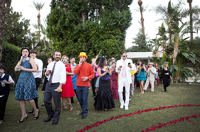 """Play Dress Up Whether it's costumes at a Halloween wedding or just hats and props for the reception, guests love an excuse to dress up. This wedding had a Beatles theme: """"Sgt. Pepper Pool Party."""" Photo by Ashleigh Taylor Photography via Green Wedding Shoes"""