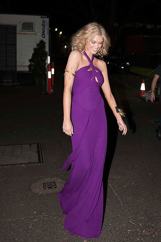 A '70s inspired look for Delta courtesy of this violet Issa gown.