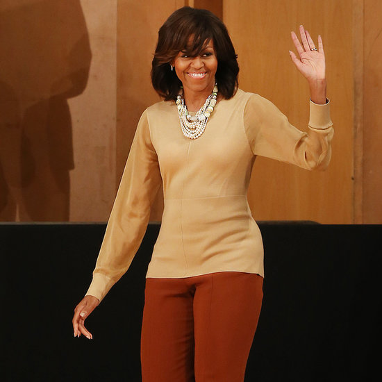 First Lady Michelle Obama Arrives in Belfast in Burberry