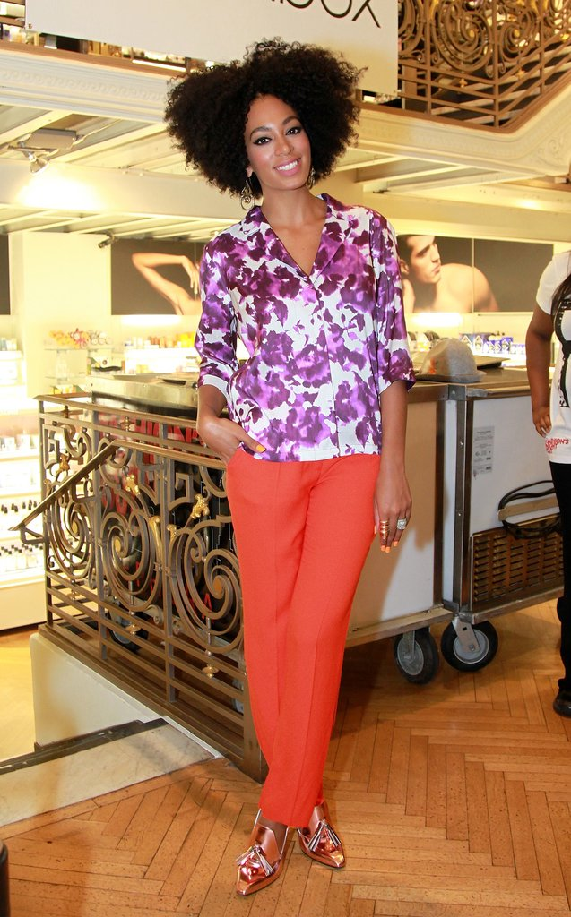 Pairing a floral purple blouse with bold orange trousers and metallic platform loafers, Solange shined bright like a diamond at Sephora's Fashion's Night Out event in 2011.