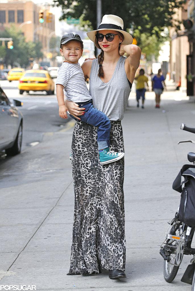 Miranda Kerr held Flynn Bloom as he showed off his smile in NYC.