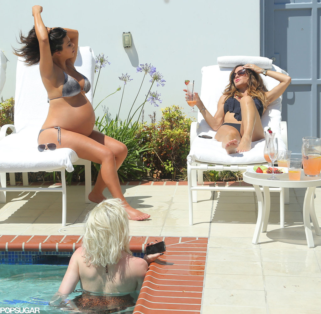 Kim Kardashian lounged by an LA pool with friends five days before giving birth.