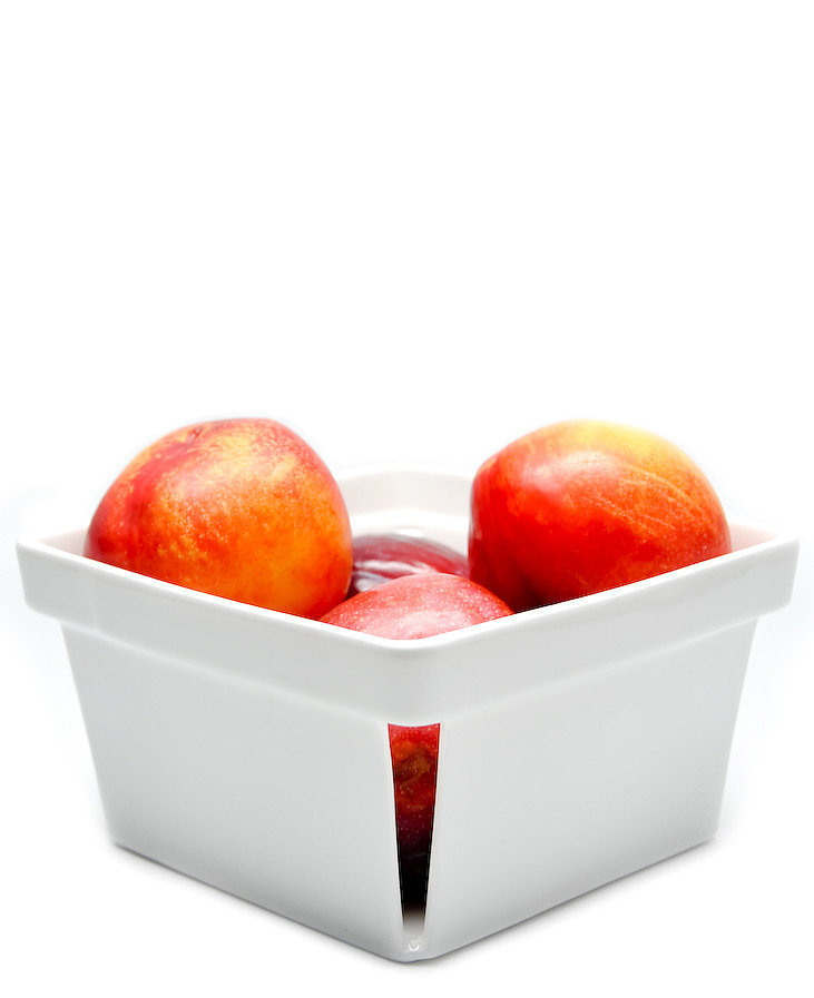 Plums, peaches, pears — this porcelain basket ($25) was made for holding your favorite fruits.